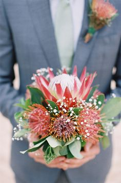 protea and pincushion floral arrangement, photo by Feather and Stone : ruffled
