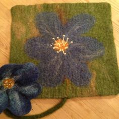 Wet felted pad with Common hepatica Tovet sitteunderlag med blåveis Rugs, Home Decor, Photo Illustration, Farmhouse Rugs, Decoration Home, Room Decor, Carpets, Interior Design, Home Interiors