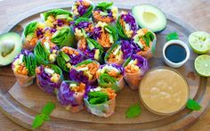 Colorful veggie rice paper rolls with peanut butter sauce | A Million Miles