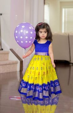 Ikkat silk baby lehengas at (PID: Ikkat silk baby lehengas Fits Kids Dress Wear, Kids Party Wear Dresses, Baby Girl Party Dresses, Kids Gown, Dresses Kids Girl, Dress Party, Kids Outfits, Girls Frock Design, Baby Dress Design