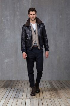 Love the contrast between the leather and the suit pants - from Brunello Cucinelli Fall 2015