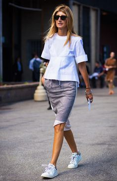 Sarah Rutson wears a cool top with a casual pencil skirt and comfy sneakers