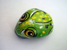 This is one of a kind handpainted 3 Dimentional Rock Art. It is varnished, it keeps its durability long years..This lovely Green Frog will bring fun