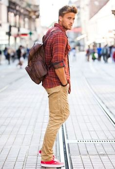 ocher pants, a plaid shirt and red Converse