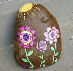 This is a sweet but rather large rock I made for one of my sisters birthday! I love flowers and pink stuff!