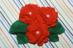 """""""Curly Red Flower"""" materials : beads & flanel size (PxL)cm : 8x9"""
