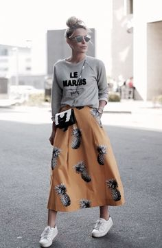 Elaborate print paired with a statement sweatshirt.