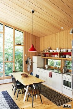 kitchen counter, windows, ceiling in this small kitchen