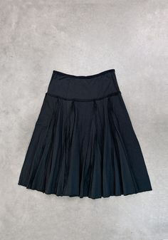 This double-layered skirt is hand-stitched using 100% organic lightweight cotton jersey. Visible outside seams and pleats add movement throughout. Shown here in Black. Please allow four to six weeks for delivery. Wash gently + Hang to dry. Free shipping. Made in the USA.
