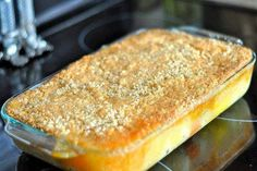 TROPICAL DUMP CAKE - INGREDIENTS: 1 20 ounce can cubed or crushed pineapple 1 15 ounce can tropical fruit 1 package of orange cake mix 1 sticks of butter cup instant oatmeal 1 cup coconut flakes DIRECTIONS : Preheat oven to 350 degrees. Cupcakes, Cupcake Cakes, Poke Cakes, Just Desserts, Delicious Desserts, Yummy Food, Creative Desserts, Cold Desserts, Homemade Desserts