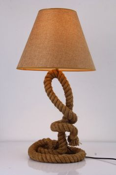 Modrest Blake Modern Rope Table Lamp VGKRKW0321T-1Product:70449Features:Hemp Rope BaseCotton Lamp Shade1 BulbBulb Type: E26 Max 60WDimensions:Table Lamp : W15