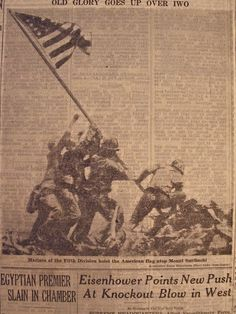 up close newsprint picture of the flag raising and the six soldiers in Iwo Jima