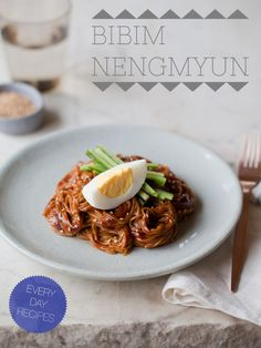 Bibim Nengmyun. Thin buckwheat noodles tossed together with a Korean-style hot pepper sauce and topped with matchstick cucumbers and a hard boiled egg to cool the palette. This dish is gluten-free and if you remove the egg.