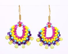 Intricate design of beaded loops. Segments of fuchsia, bright yellow, matte turquoise, bold purple, shiny green and just a touch of sparkling orange are woven with different size and shape seed beads as two shades of green glass drops offer an artistic touch at the bottom of each loop. Bold and beautiful, these handmade earrings are a stylish statement piece for every woman. Gold color metal earrings. Handmade in USA.  Length: 1.5/ $25.00  Other color combinations are available upon request.