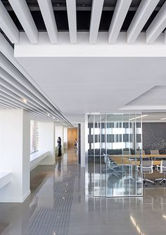Cushman & Wakefield's new San Francisco office with modern amenities and design elements features polished concrete floors, baffled ceilings and sliding doors. http://www.bcciconst.com/what-we-build/sustainable/cushman-wakefield/