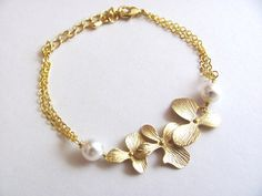 Gold Triple Orchid and Double Pearl Bracelet by ACutieChick, $25.00