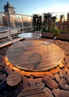 This pallet wood DIY idea is amazing and unique for your sitting arrangement at your terrace or balcony. This is actually made out of pallet wood dismantled planks and then used as a base or floor for the sitting arrangement. The wooden platform has been given this stunning under-lit effect. The overall environment is ethereal and heavenly.