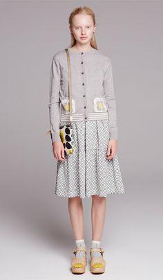 Orla Kiely Love Bird Intarsia Cardigan worn with Orla Kiely Shadow Flower Jersey T-Shirt Dress shown with Orla Kiely Summer Flower Travel Pouch in sunshine