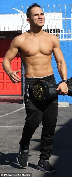 Ripped! Carlos PenaVega showed off his chiselled chest as he went shirtless