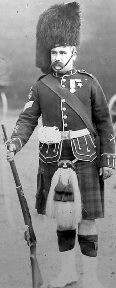 Old photograph of a Black Watch Sergeant in St Andrews, Fife, Scotland. His medals indicate that he is a veteran of the 1882 Egyptian campaign.