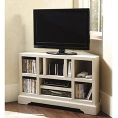 Corner Media Console--so effing smart. great way to maximize space.