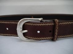 HENRY BEGUELIN brown leather with stitched family and silver metal buckle belt