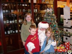 Santa looks great.  The kids look happy.  The liquor store background..hmmm.