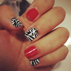 red nails with zebra accents
