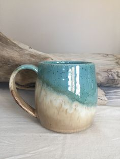 Large wheel thrown comfort mug in 'Cocoa Mint'. Turquoise green and taupe.