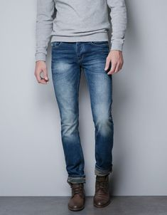 FADED JEANS WITH CAMOUFLAGE HEM