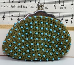 Hey, I found this really awesome Etsy listing at https://www.etsy.com/listing/127296711/coin-purse-vintage-crocheted-and-beaded