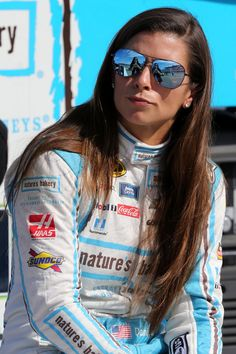 Danica Patrick Photos - Danica Patrick, driver of the #10 Nature's Bakery Chevrolet, stands on the grid during qualifying for the NASCAR Sprint Cup Series New Hampshire 301 at New Hampshire Motor Speedway on July 16, 2016 in Loudon, New Hampshire. - New Hampshire Motor Speedway - Day 1