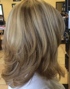 Medium layered cut with discreet layers and highlights looks healthy and youthful. Photo credit- therighthairstyles.com