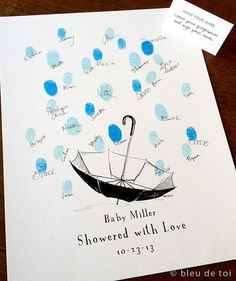 So creative to remember and display! Baby Shower Umbrella with Thumbprint Raindrops Guest Photo - by bleudetoi #uniquebabyshowerideas #greatgift #pettydetails