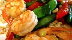 This quick and tasty main dish has a double hit of sesame oil and seeds that add nutty flavor to crisp peppers and shrimp.