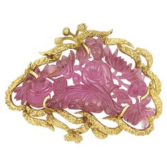 Gold and Carved Pink Tourmaline Pendant-Brooch 18 kt., one carved pink tourmaline ap. 27.0 x 52.0 x 4.7 mm., ap. 16.6 dwt. gross.