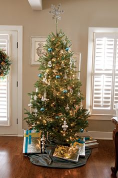 Continue your color theme with the wrapped presents under the tree. Sparkling metallic paper is accented with touches of blue.
