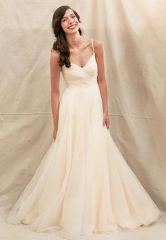 Fancy spaghetti straps informal wedding dress @Charley Williams this would be pretty with a long flowy train!