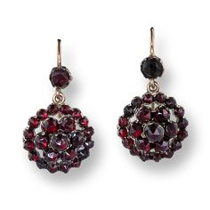 Bohemian Garnet Cluster Earrings. Original nineteenth-century Bohemian (Czechoslovakian) drop earrings composed of dark burgundy rose-cut garnets arrayed in a flower-like cluster suspended from a single garnet in yellow gold with wire backs.