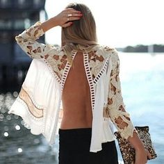 Wow, a sexy feminine look.  Love the cutouts and the gauze look.  Lovely if it can be worn with the opening in front, worn over a simple solid tank.