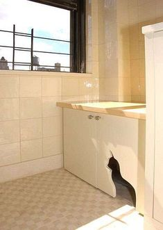 Cat Silhouette Cutout Allows Access to Litter Box in Cupboards #pets