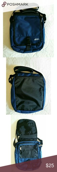 """""""JUST IN"""" Messenger Bag NWOT  Never used  Strap 48 inches long Nylon 12"""" H x 9.5"""" W x 4"""" D  1 exterior open back pocket 2 exterior zippered  front pockets 1 front open pocket 1 front Velcro closure pocket   Color navy blue NOTE See picture #3 all the six pockets shown .            See picture #2 main compartment Made in Vietnam Mountain Equipment  CO-OP Bags Crossbody Bags"""