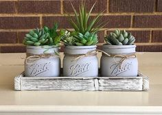 mason jar crafts Give your home or office a farmhouse style with these charming faux succulents in mason jars and planter box. This mason jar is perfect for any room in your home and w Pot Mason Diy, Rustic Mason Jars, Mason Jar Gifts, Painted Mason Jars, Mason Jar Kitchen Decor, Kitchen Rustic, Country Kitchen, Mason Jar Succulents, Faux Succulents