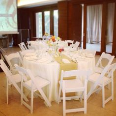 Reservs White Folding Chairs At A Food Tasting Event By Josiahs Catering The Blue Leaf