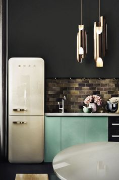 stunning dark kitchen with skinny retro fridge and turquoise cabinets