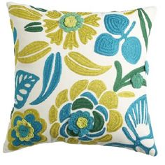 $24.98 Pier 1 pillow. Turquoise, lime colors might look good with grays/browns http://www.pier1.com/Crochet-Crewel-Floral-Pillow/2582601,default,pd.html?cgid=pillows