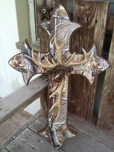Camo cross with antlers