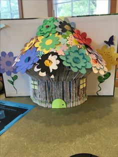 Fairy house folded into a recycled out of date encyclopedia.