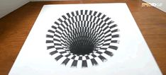 A pencil and a paper is all you need to draw these magical anamorphic black holes that will make your brain think that there is a whole different dimension under your table.