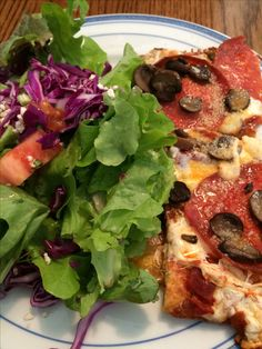 A beautiful fresh salad dressed with hazelnut oil and raw apple cider vinegar and low carb mushroom and pepperoni pizza with a cheese crust.